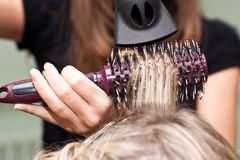 Hairdresser dries the hair in a beauty salon Royalty Free Stock Image