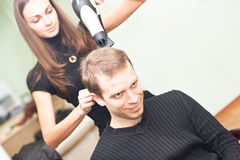 Hairdresser dries the hair guy Royalty Free Stock Images