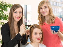 Hairdresser dying hair of client Royalty Free Stock Image
