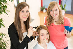 Hairdresser dying hair of client Stock Image