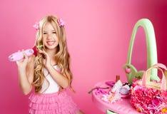 Hairdresser fashion girl with hair curler Stock Photos