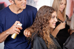 Hairdresser Fixing Woman's Hair With Spray Royalty Free Stock Photography