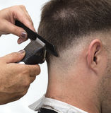 At the hairdresser. Getting a new male haircut Royalty Free Stock Image