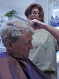 Hairdresser gives man haircut Stock Photography