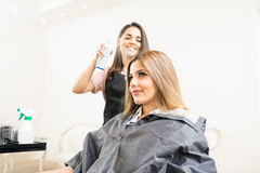 Hairdresser giving the finishing touches Stock Photo