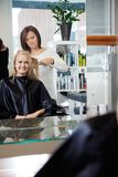 Hairdresser Giving Haircut To Woman Royalty Free Stock Image