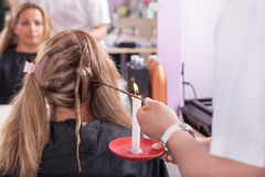Hairdresser giving a Velaterapia treatment of woman Stock Image