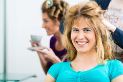 Hairdresser - hair stylist cutting hairs Stock Image