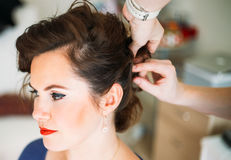 Hairdresser hands doing hair for client Stock Image