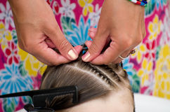 Hairdresser hands weaving a dreadlocks Stock Photo