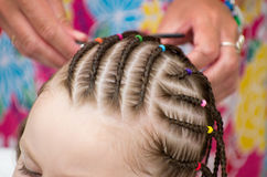 Hairdresser hands weaving a dreadlocks Royalty Free Stock Photos
