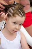 Hairdresser hands weaving a dreadlocks Royalty Free Stock Photo