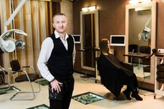 Hairdresser in a high tech studio and his client waiting ready for him royalty free stock photos