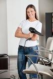 Hairdresser Holding Hair Dryer At Salon Royalty Free Stock Image