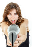 Hairdresser holding hairdryer like gun and pointing at camera  Stock Images