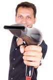 Hairdresser holding professional blow dryer Royalty Free Stock Images