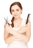Hairdresser holding a  scissors and comb Royalty Free Stock Photo