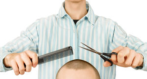 Hairdresser holding scissors and comb Royalty Free Stock Image