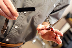 Hairdresser holding scissors and razor hands in the barbershop Stock Photography