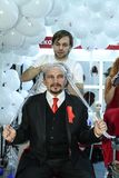 Hairdresser increases a client hair. MOSCOW - OCTOBER 26: Hairdresser increases a client hair at the international exhibition of professional cosmetics and Stock Photos