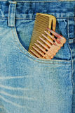 Hairdresser jean with two comb. In the pocket closeup background royalty free stock images