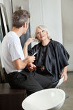 Hairdresser Listening To Female Client Royalty Free Stock Images