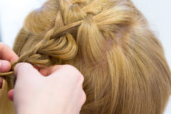 Hairdresser make braids Stock Images