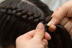 Hairdresser make braids Royalty Free Stock Image
