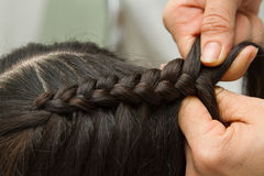 Hairdresser make braids Royalty Free Stock Images