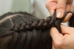 Hairdresser make braids Royalty Free Stock Images