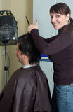 Hairdresser make clips to the men. In the hairdressing saloon Royalty Free Stock Photography
