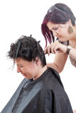 The hairdresser make the haircut Stock Image