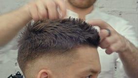 Hairdresser make hairstyle, applying hair gel stock video