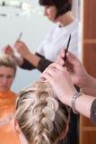Hairdresser make a headdress Royalty Free Stock Image
