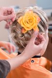 Hairdresser make a headdress Royalty Free Stock Photography