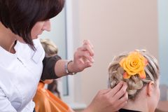 Hairdresser make a headdress Royalty Free Stock Photography