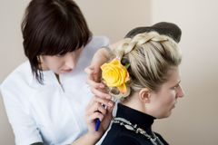 Hairdresser make a headdress Stock Image