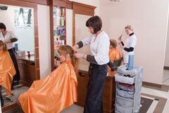 Hairdresser make a headdress Royalty Free Stock Images