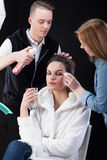 Hairdresser and make-up artist working Stock Image