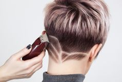 Free Hairdresser Makes A Creative Haircut With A Razor To A Beautiful Woman Stock Image - 133024141