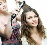Hairdresser makes hairstyle Royalty Free Stock Photos