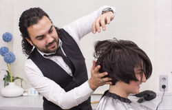 Hairdresser makes hairstyle Stock Photography