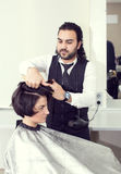 Hairdresser makes hairstyle Stock Images