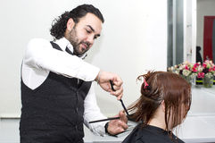Hairdresser makes hairstyle Royalty Free Stock Photography
