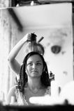 Hairdresser makes hairstyle to girl. Black and white Royalty Free Stock Photos