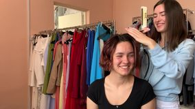 Hairdresser makes styling. And makeup for pretty woman model stock video