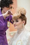 Hairdresser makes the wedding hairstyle. Stock Photo
