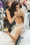 Hairdresser makes the wedding hairstyle. Stock Images
