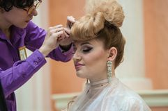 Hairdresser makes the wedding hairstyle. Royalty Free Stock Photos