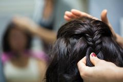 Hairdresser making a braid Royalty Free Stock Photo